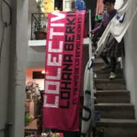 Mariela displays a banner made by Seriagrafistas Queers