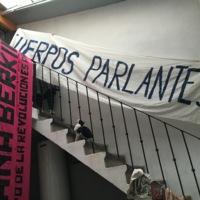 Mariela displays printed banners in the studio